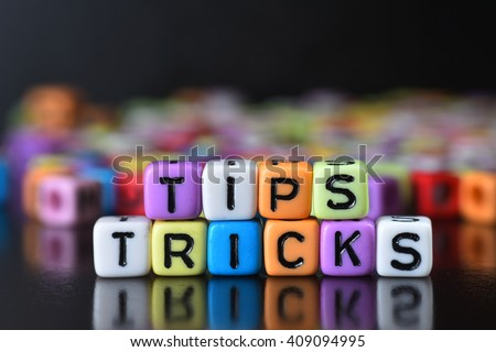 Tips and trick on colorful dice - stock photo