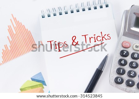 Tips and Tricks concept - Financial accounting stock market graphs analysis. Calculator, notebook with blank sheet of paper, pen on chart. Top view - stock photo