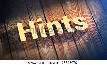 """Tips and tricks. The word """"Hints"""" is lined with gold letters on wooden planks. 3D illustration jpeg - stock photo"""
