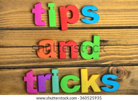 Tips and Tricks word on wooden table - stock photo