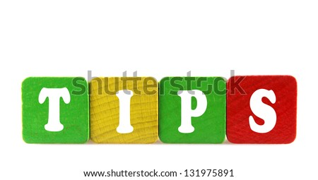 tips - isolated text in wooden building blocks - stock photo