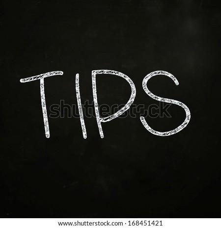 Tips Lettering, written with Chalk on Blackboard - stock photo