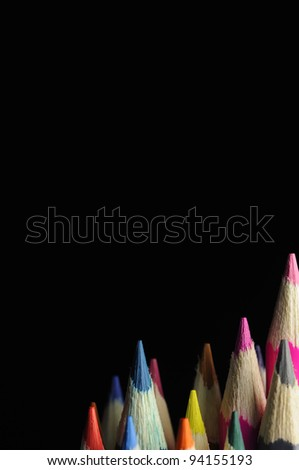 Tips of Colored Pencils on Black Background - stock photo