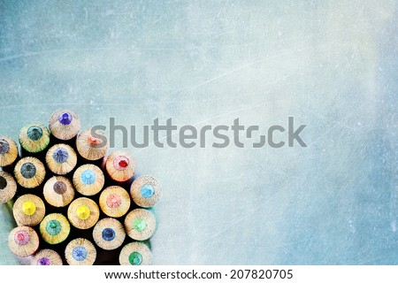 Tips of coloring pencils over a textured background. Extreme shallow depth of field. - stock photo