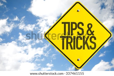 Tips & Tricks sign with sky background - stock photo