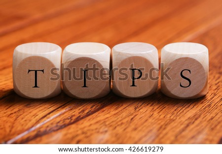 TIPS word wooden blocks are on the floor. - stock photo