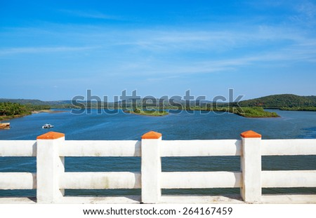 Tirakol river and white fence - stock photo