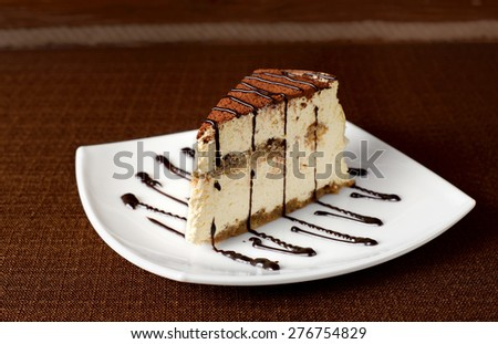 Tiramisu cake on a white plate.Dessert. - stock photo