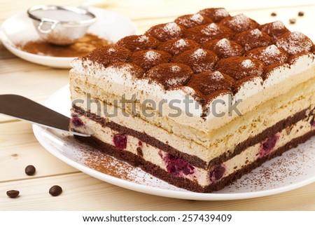 tiramisu cake on plate - stock photo