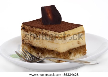 Tiramisu cake on the plate over white background