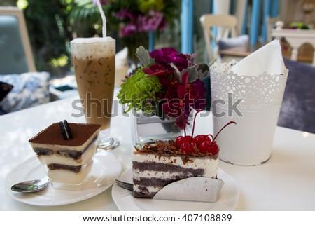 Tiramisu chocolate cake and chocolate cake and cherry topping - stock photo