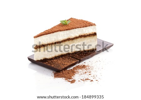 Tiramisu dessert on chocolate bar isolated on white background. Italian sweet dessert concept. - stock photo