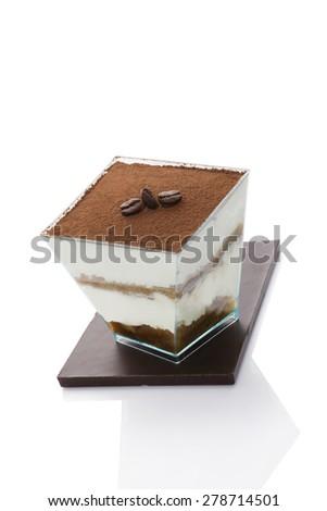 Tiramisu dessert on chocolate bar isolated on white background. Italian sweet dessert concept. - stock photo