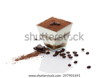 Tiramisu dessert with coffee beans, chocolate bar and cocoa powder isolated on white background. Traditional tiramisu dessert, modern minimal style.  - stock photo