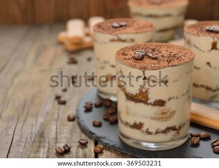 Tiramisu on a brown background - stock photo
