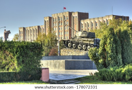 TIRASPOL, TRANSNISTRIA - OCTOBER 20: parliament building and tank on October 20, 2013 in Tiraspol, Transistria. Tiraspol is the capital of Transnistria, a self governing territory not recognised by UN - stock photo