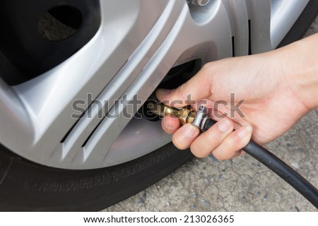 Tire air pressure checking before travel. - stock photo