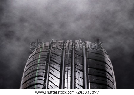 Tire Car with smoke on black background  - stock photo