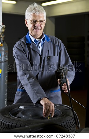 Tire change technician in the repair shop