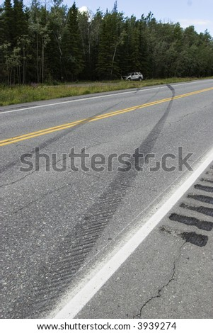 Tire marks and car rolled over - proof of someones careless driving