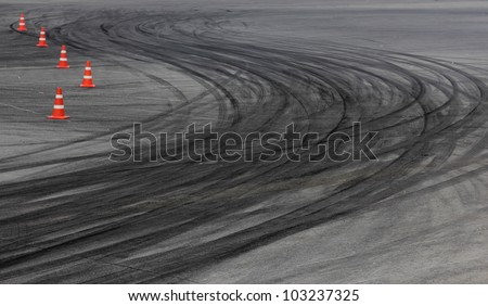 Tire marks on road track - stock photo