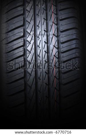 Tire on black background - stock photo