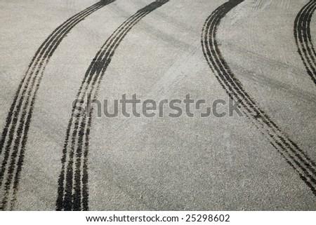 Tire print on the asphalt road - stock photo