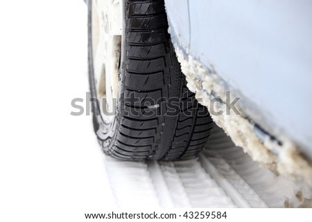 Tire prints in the snow ( winter tire ) focus on tread - stock photo