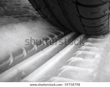 Tire trace on snow - stock photo