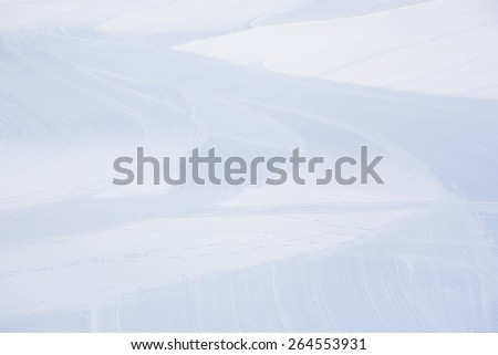 tire trace on the snow - stock photo