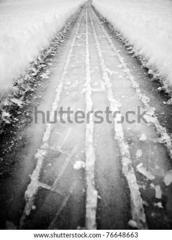 Tire track in the snow - stock photo