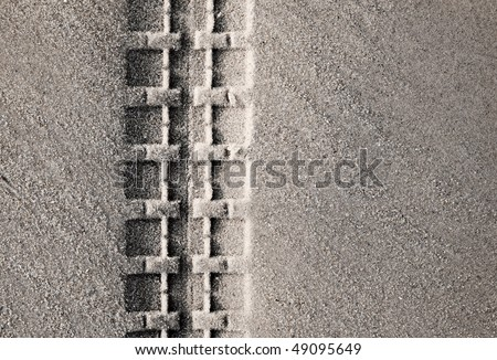 Tire track on the beach - stock photo