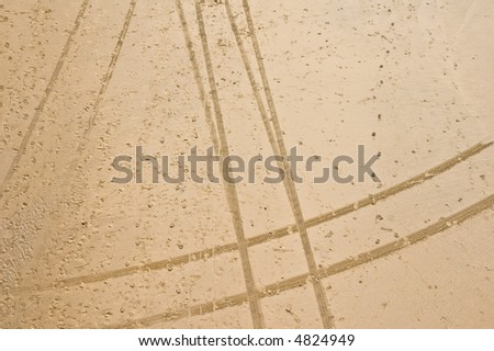 tire tracks in sand on the beach texture - stock photo