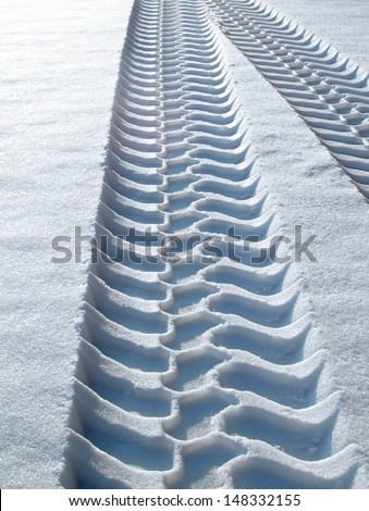 tire tracks in snow - stock photo