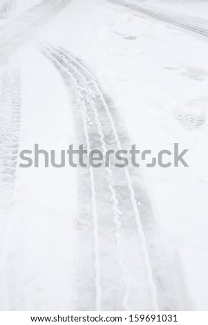 Tire tracks in snow - stock photo