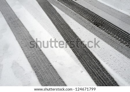 Tire tracks in the fresh snow - stock photo