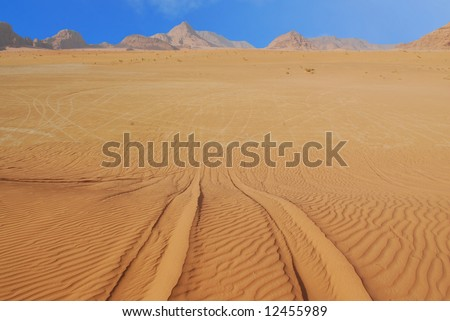 Tire tracks in the sand in Wadi Rum desert, Jordan - stock photo
