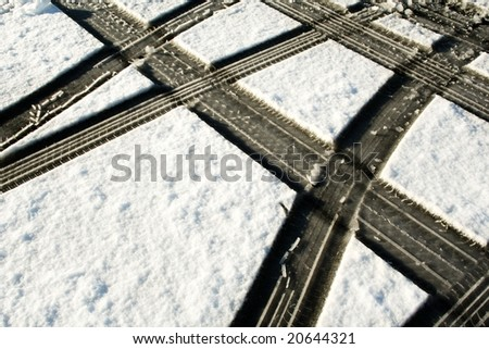 tire tracks in the snow - stock photo