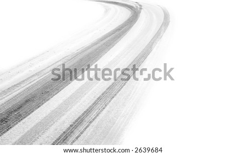 tire tracks in the snow, fading into white one both sides - stock photo