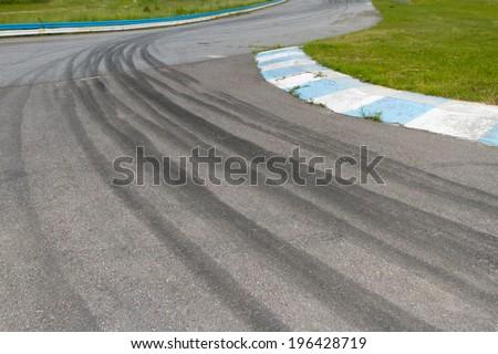 Tire tracks on asphalt - stock photo