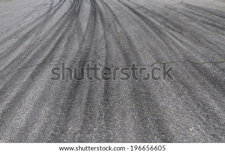 Tire tracks on asphalt - stock photo