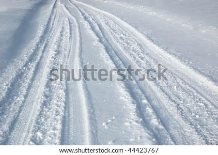 tire tracks on snow - stock photo