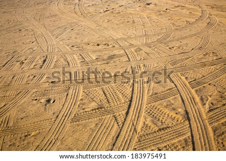 Tire tracks on the sand. - stock photo