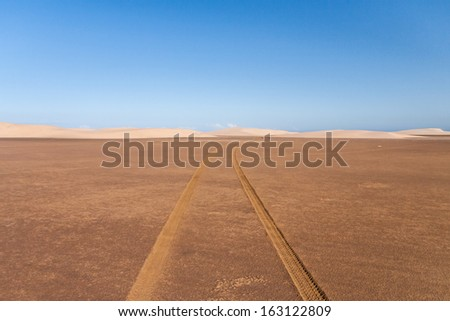 Tire tracks through the desert sand dunes in southern Madagascar - stock photo