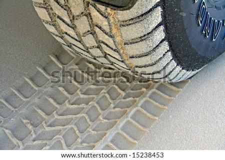Tire Tread and Imprint on Sand - stock photo
