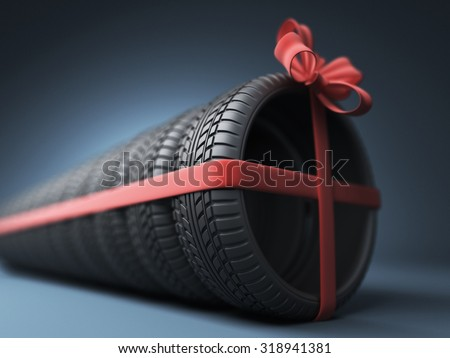 Tire with a red ribbon. Gift. 3D Icon isolated on blue background - stock photo