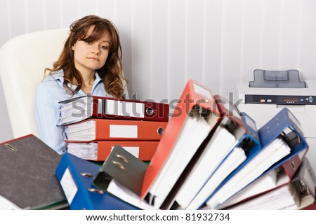 Tired accountant working overtime in the office workplace - stock photo