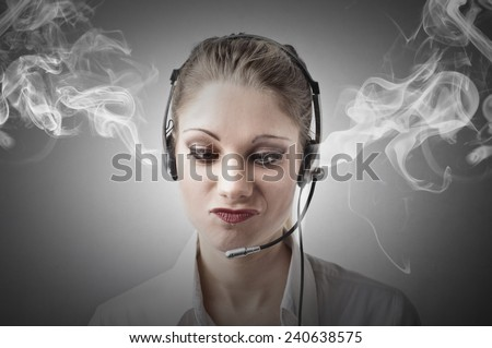 Tired and angry receptionist  - stock photo