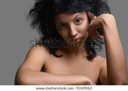 Tired and diappointed girl on a grey background - stock photo