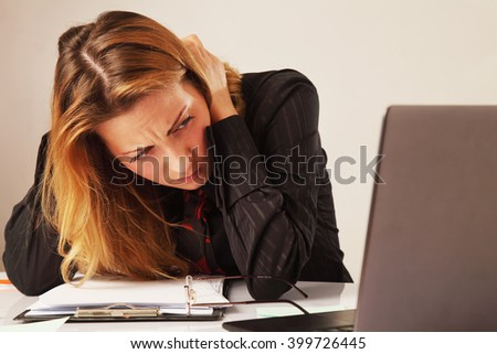 tired and exhausted business woman working  working with laptop (psychological portrait, aggression, anger, frustration) - stock photo